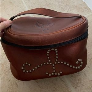 Two bar leather toiletry bag